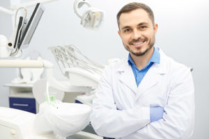 smiling male dentist with crossed arms, about lovett dental pasadena