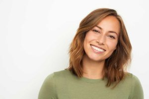 a woman benefits from teeth whitening